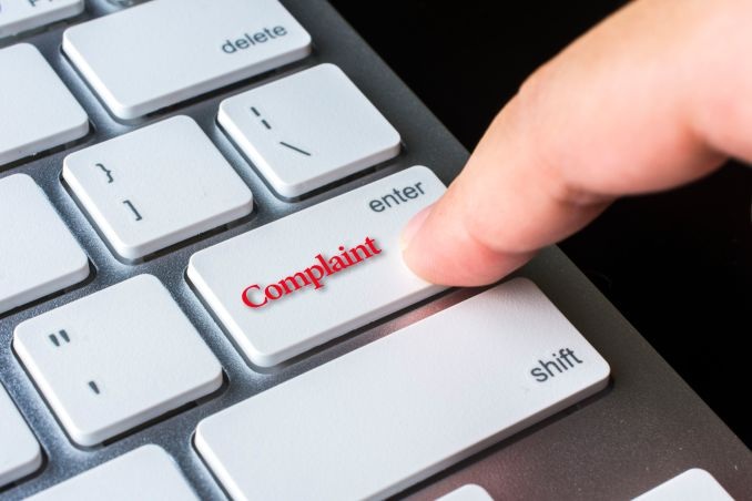 Finger on computer keyboard keys with Complaint word